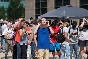 Students looking at Solar Eclipse